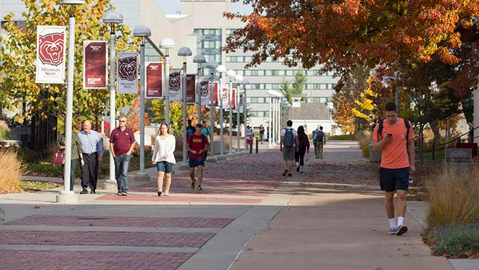 wideshot of people walking on campus
