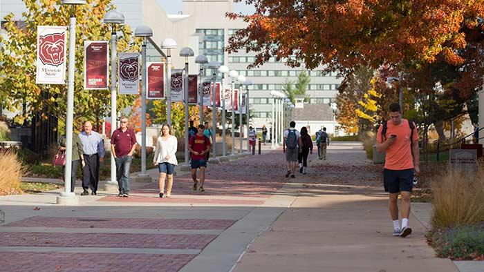 wideshot of people walking on campus