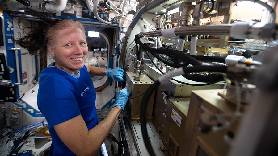 NASA astronaut Shannon Walker sets up science hardware components inside the Destiny laboratory module's Microgravity Science Glovebox.