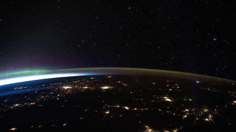 The city lights of northwest America, highlighted by an aurora, are pictured as the space station orbited above.