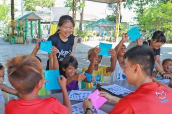 Carrying out origami lessons for the children in Pugaro Integrated School.