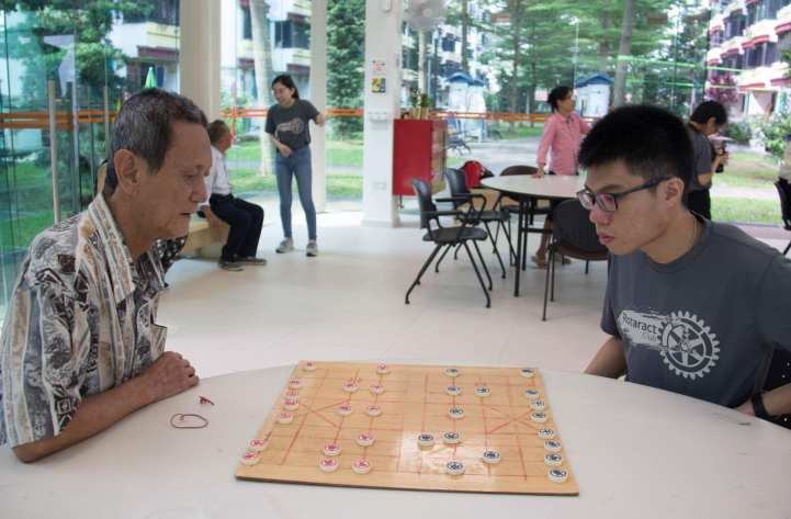 A battle of wits in a game of Chinese chess.