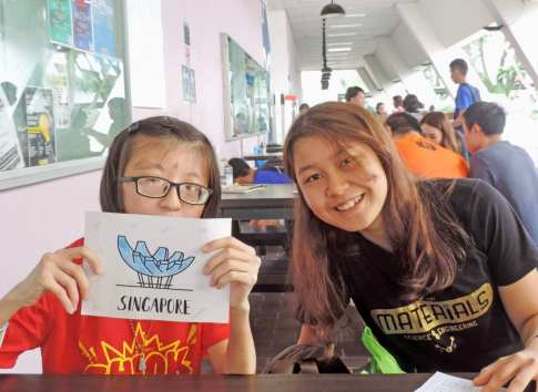 A participant showing off her colouring artwork of iconic Singapore landmarks.