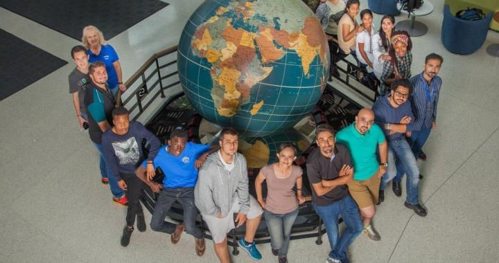 KCC CCI students and globe