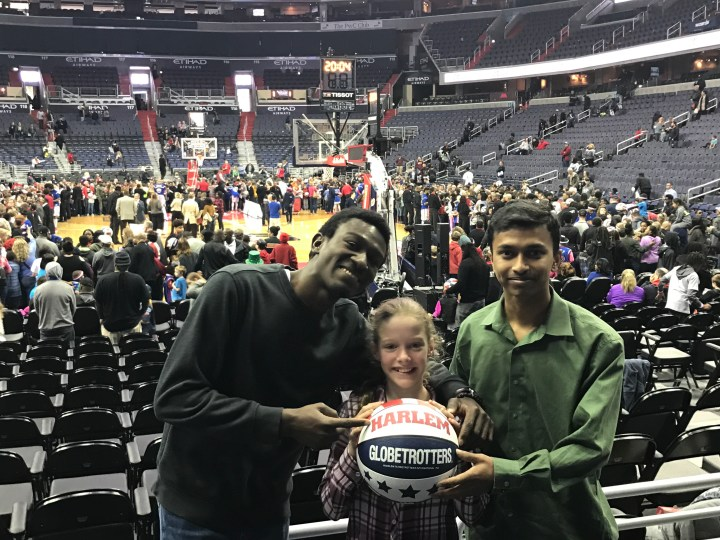 Ebenzer and Mehedi at a basketball game
