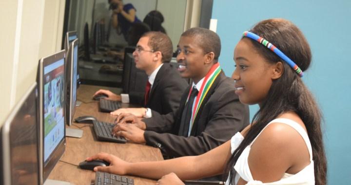 Nkululeko, Juliet, and Daniel sitting at computers.
