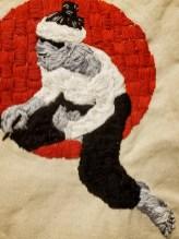 "16A.Detail: Izabo Pintando, Embroidery on canvas, Wooden tool handle, Denim, Cast Iron Hooks, 13"" x 27"""