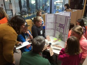 students tell engineering judges about their wind turbine design