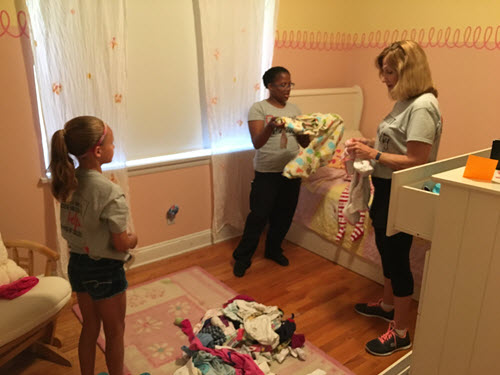 Perficient volunteers folding laundry at the Crisis Nursery