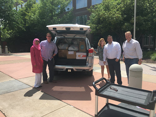 Perficient volunteers with Crisis Nursery donations from the St Louis office
