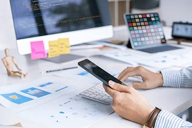 Software developer working on desktop and mobile design