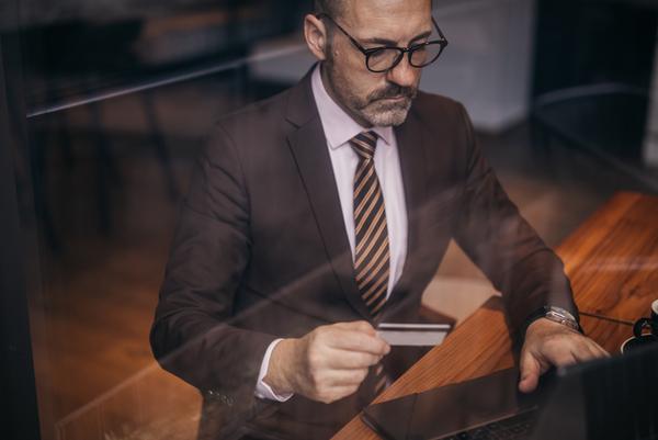 Senior Businessman With Eyeglasses Shopping Online