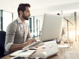 Man Working At His Computer