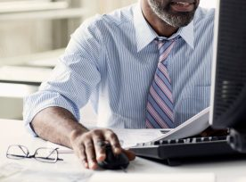 African American Man At Desktop Computer In Office