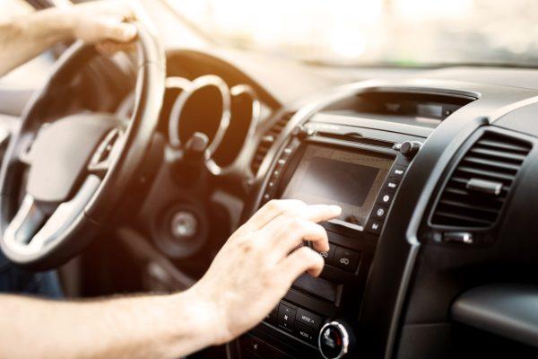Man Using Navigation System While Driving Car