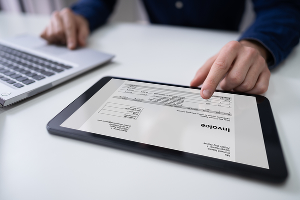 Businessman Working With Invoice On Digital Tablet