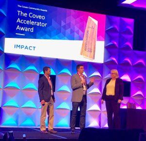 Eric Immermann, Director of Search and Content at Perficient, accepts the 2019 Coveo Accelerator Award at Coveo Impact.