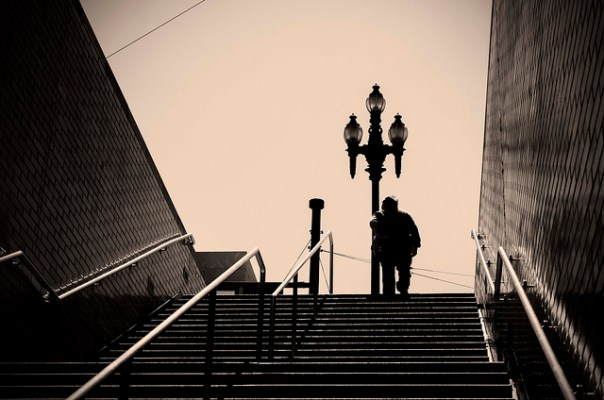 Photograph of a person up a flight of stairs into the open. by flickr user Allen, licensed CC:BY.