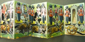 "Five-leaf accordion-fold with toy soldiers for readers to cut out, assemble, and arrange in ""innumerable tableaux."""
