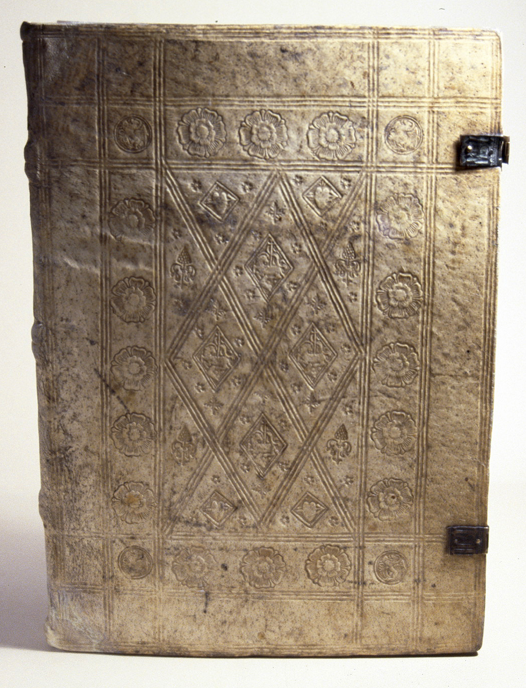 18afd99bfad78 The tooled emblems found on the binding
