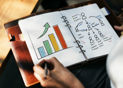 An open notebook where a graph reflecting business growth is drawn.