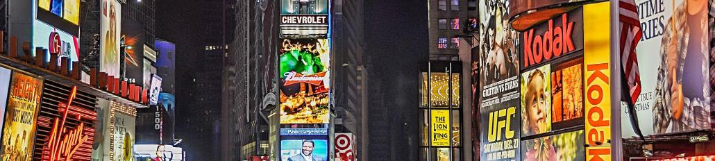 City illuminated by adverts