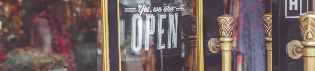 Open sign in vintage shop window