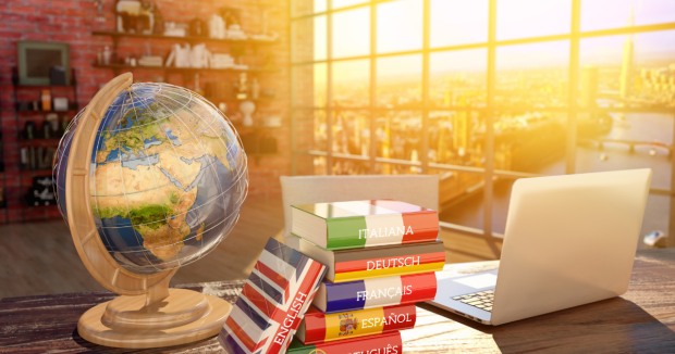 Globe, laptop and languages books