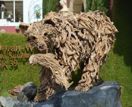 Driftwood bear with fish