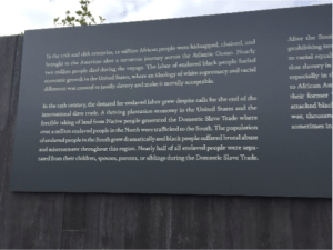 Sign presenting narrative of lynchings at memorial in Montgomery Alabama