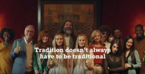 "family in heineken commercial with caption ""Tradition doesn't always have to be traditional"""