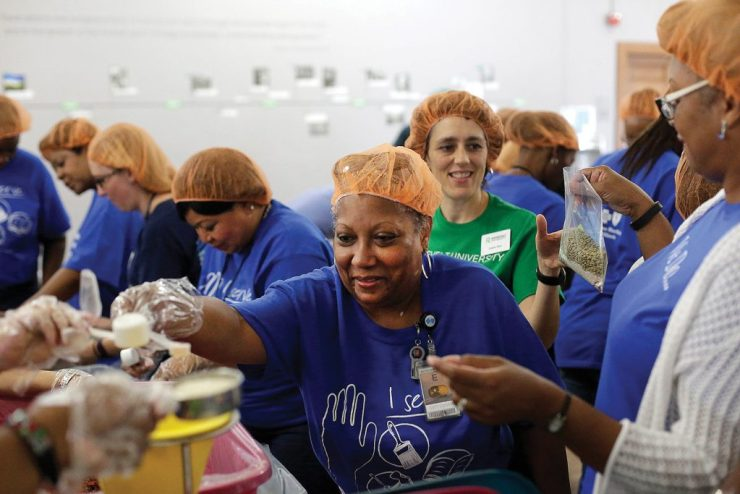 Teams from Roosevelt and from BlueCross BlueShield of Illinois put together meals for the homeless.