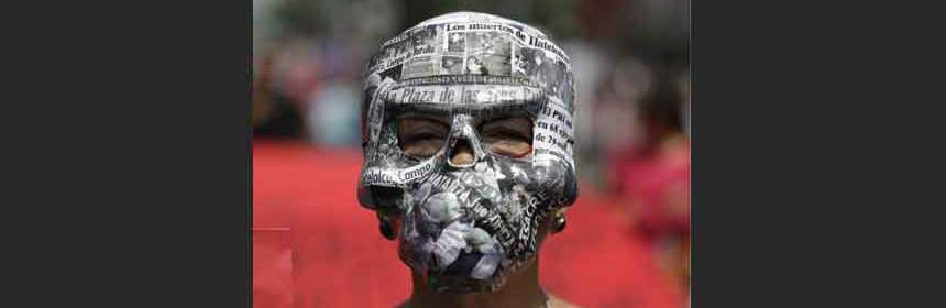 Image of woman wearing newspaper skull mask