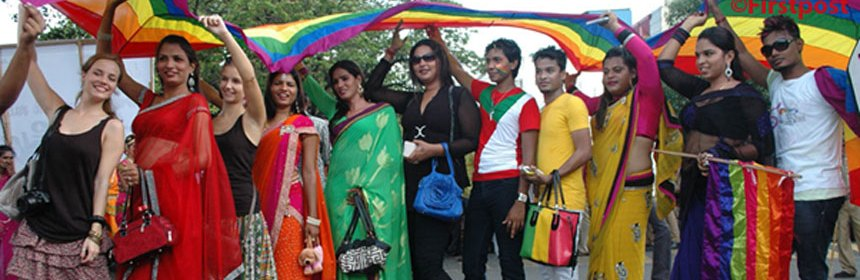 Raghavan Seminar - Image of a group of people of different cultures holding rainbow flags.