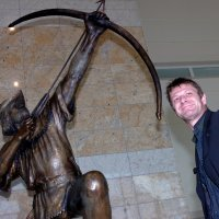 Doncaster Star News: 28 Feb 2007. Film star Sean Bean is pictured with the statue of Robin Hood at Robin Hood Airport.