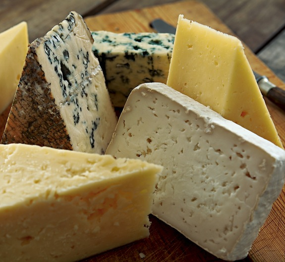 New evidence indicates cheese was invented as far back as 5000 BCE, although ancient cheeses wouldn't have been as varied or refined as the cheeses we have today. Image via Flickr user Skansa Matupplevelser