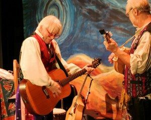 "John Gretzinger and Bryan Ibach, onstage during a performance of ""The Legend of Old Befana"" t the Sawdust Theatre in Coquille, Oregon"