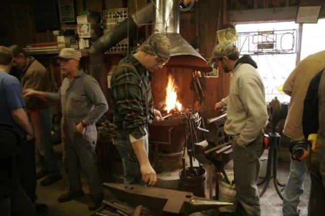 Students learn blacksmithing with CCC instructor David Curl.