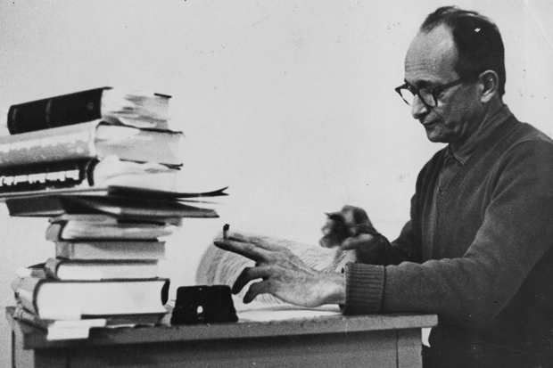 Former SS and Nazi leader Adolf Eichmann (1906 - 1962) in Nazareth, preparing his defence in the trial brought against him for war crimes (Photo: Evening Standard/Getty)