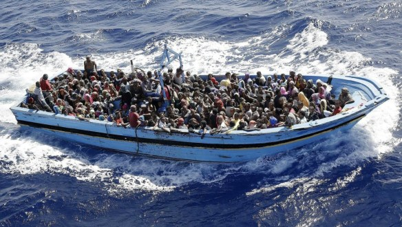 Boat full of people in the sea