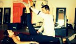 Stretching under the guidance of a personal trainer.