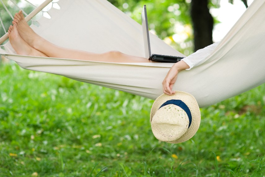 person in hammock with laptop