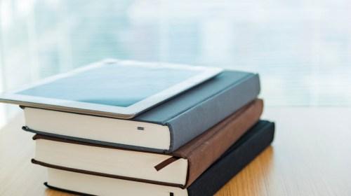 ipad on top of books