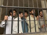 Arrested gang members of a sexual abuse scandal stand in the police lockup in Hussain Khanwala village, some 55 kms southwest of Lahore on August 9, 2015. PHOTO: AFP
