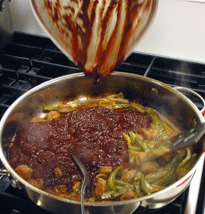 add red salsa to the chorizo/nopales/onion mix