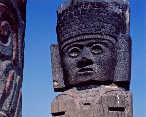 the volcanic stone face of one of the Toltec warriors or 'Atlantids' at Tula, Mexico