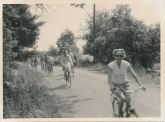American Youth Hostels, photograph of bicycling tour, circa 1950-1959. Pictured are a group of cyclists on a tour coordinated by the American Youth Hostels.
