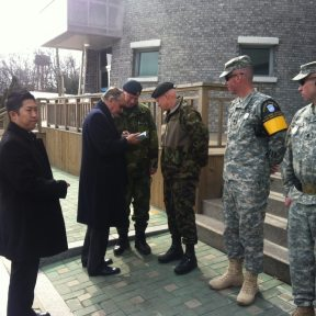 While in the Republic of Korea, Deputy Secretary-General Jan Eliasson signs a copy of the UN Charter for one of the officers in the Demilitarized Zone.