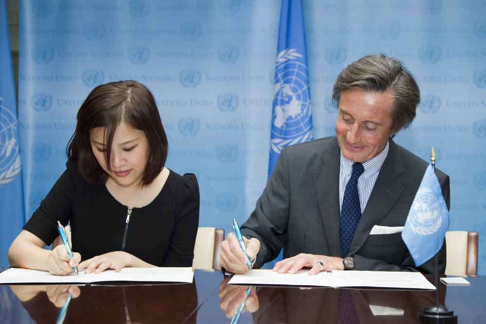 """signing ceremony"" which took place on Friday April 19th between CBN NY Correspondent Ms. Weier Ge and USG Peter Launksy-Tieffenthal at UNHQ"