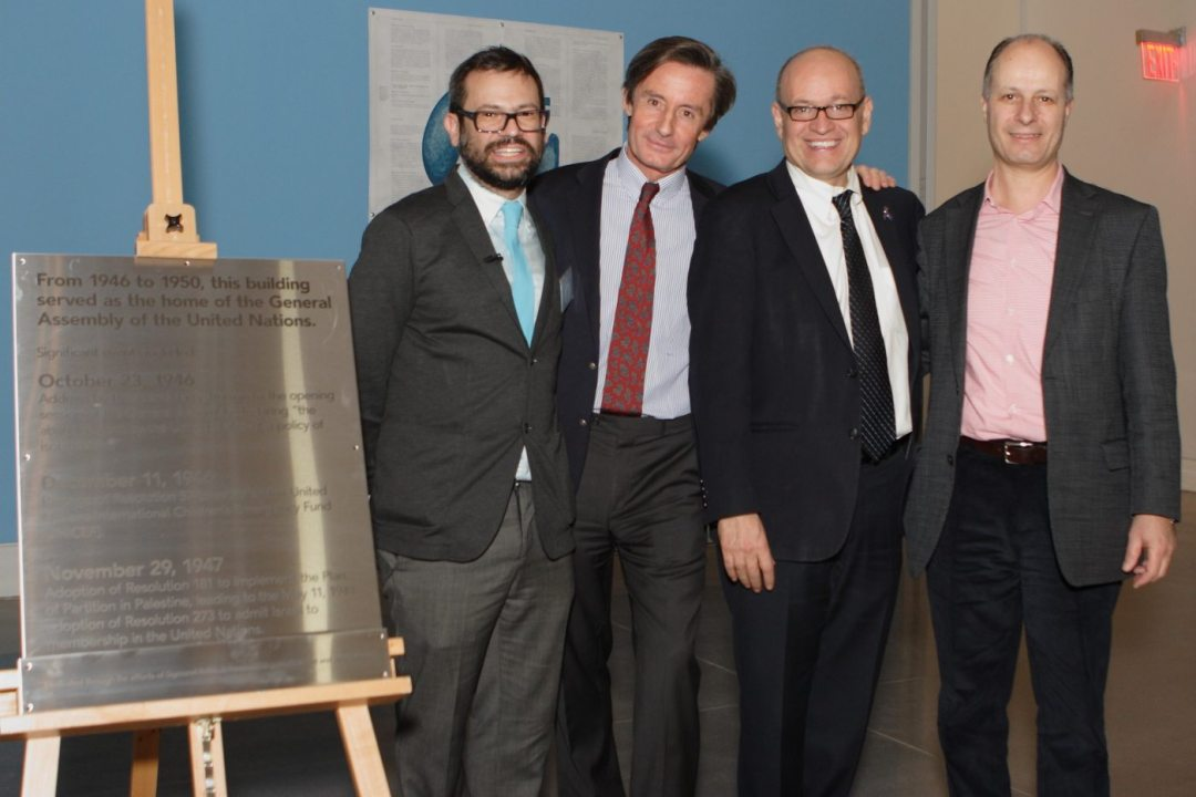 Artist Pedro Reyes, UN Under-Secretary-General for Communications and Public Information (DPI) Peter Launsky-Tieffenthal, Queens Museum Executive Director Tom Finkelpearl and DPI Outreach Division Director Maher Nasser stand by the new plaque commemorating the United Nations General Assembly meetings between 1046-1950 in Flushing Meadows, Queens, New York.